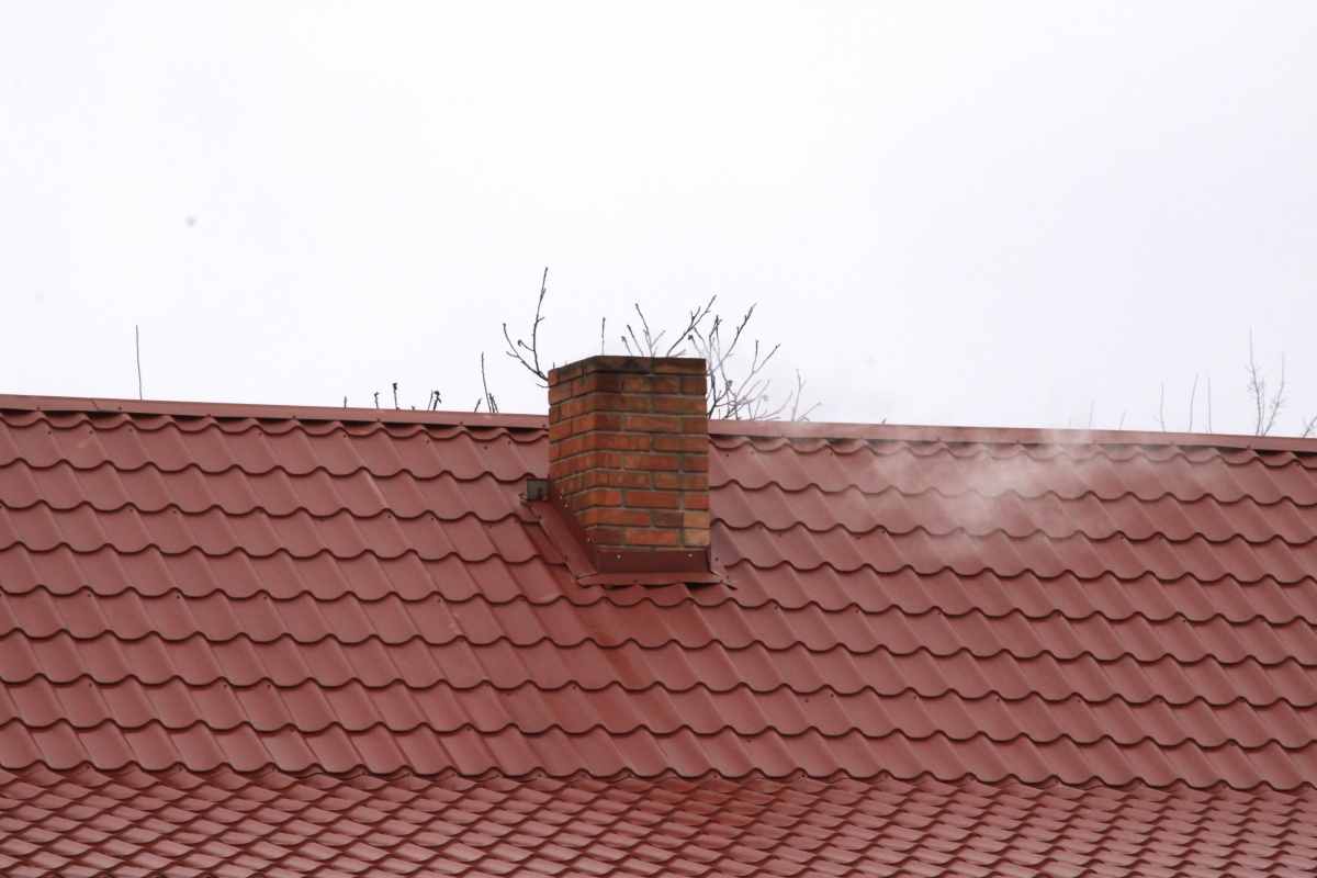 chimney on the roof of metal 1239959694 94